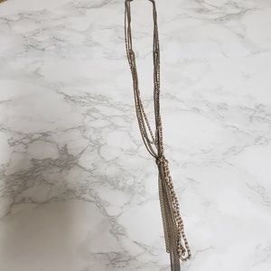 Long chain and tassel necklace